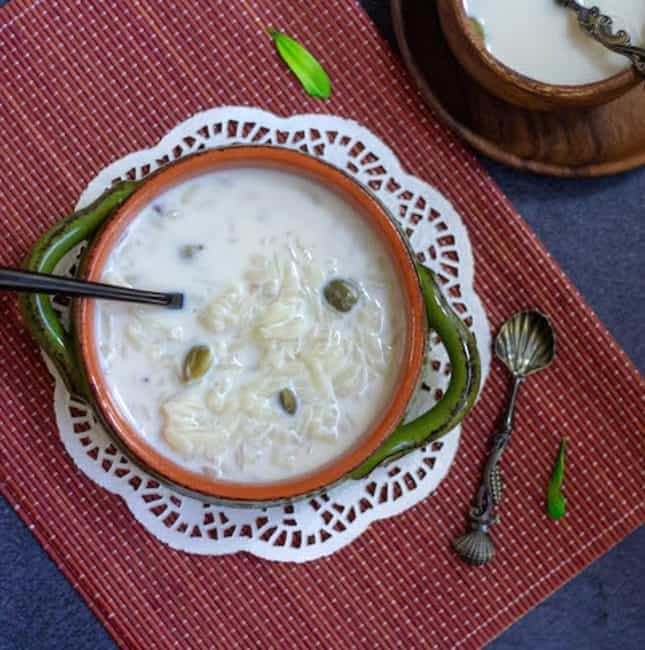 aval payasam on a ceramic pot with a spoon on the side
