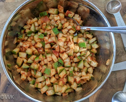 mixing the instant cut mango pickle