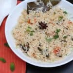 square image of coconut milk rice served in white bowl