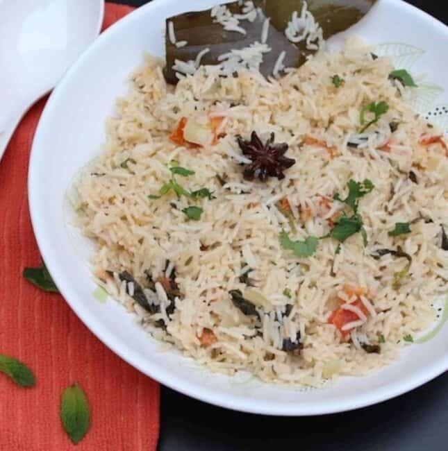 square image of coconut milk rice served in white bowl