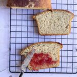 square image of wheat bread slice placed on cooling rack