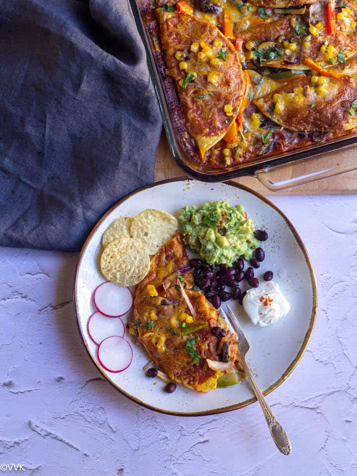 enchilada served with guac, beans and sour cream