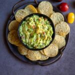overhead shot of guacamole served with chips