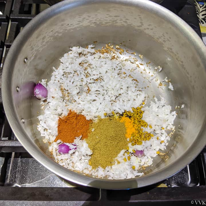roasting coconut and spices for ulli theeyal