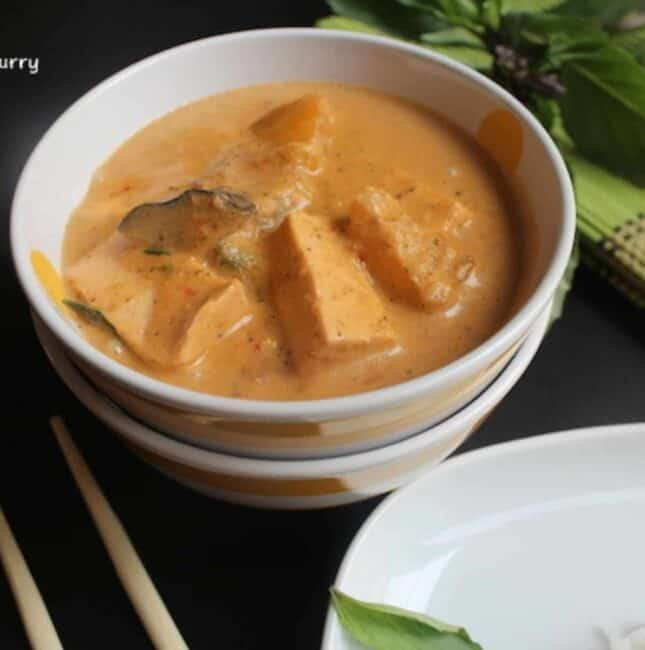 thai red curry served in white bowl