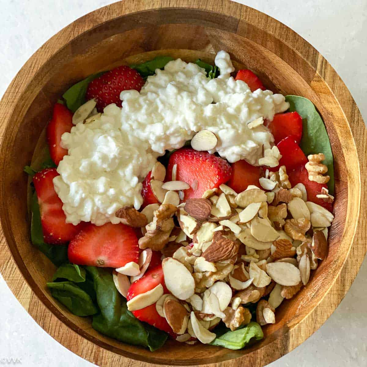 adding the spinach, strawberries, nuts and cottage cheese