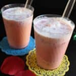 Serving Jil Jil Jigarthanda with China Grass and Evaporated Milk in two glasses