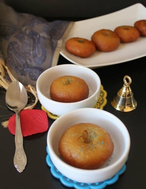 Badusha or Balushahi looking extra yummy and served in three different bowls, decorated with festival specials