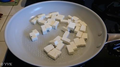 Adding paneer to the hot pan