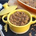 Serving Kongu Nadu Style Kollu or Horse Gram Kadaiyal aka Masiyal in a mini yellow pan with a spoon on the side