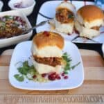 Dabeli Sandwich looking extra inviting and served with pomegranate seeds on a white plate