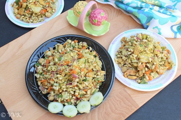 indian street food bhelpuri with cucumber slices in a black plate