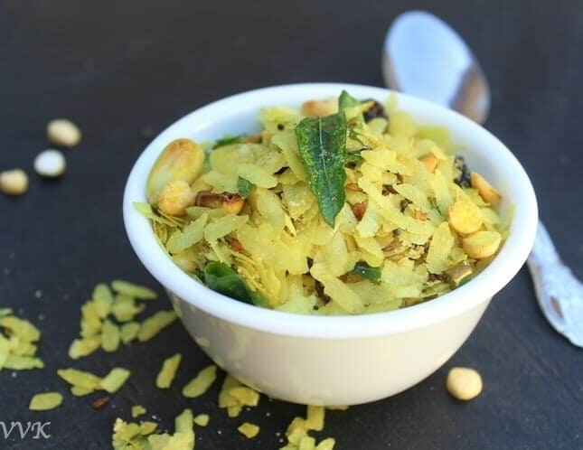 Chivda or Namkeen Chiwda aka the Bombay Mix ready and served in a small white bowl with a spoon on the side
