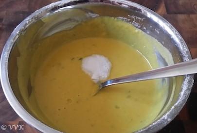 Adding the eno fruit salt to a pan