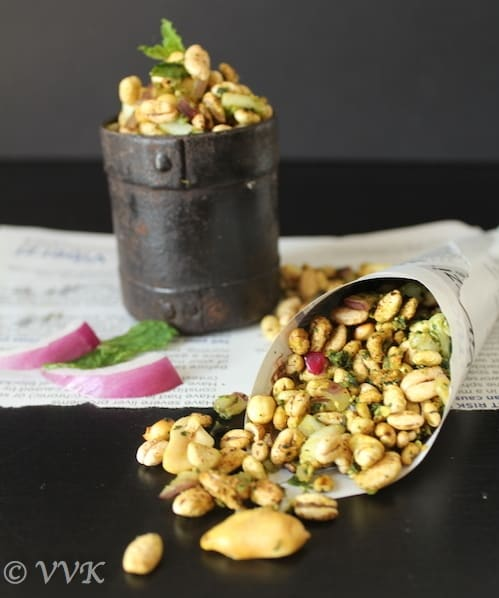 Sukha Bhel with Barley Puffs ready and served on a piece of newspaper, scattered on a dark table