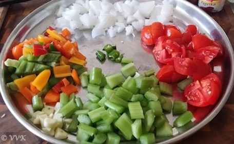 Veggie ingredients prepared on a big metal tray