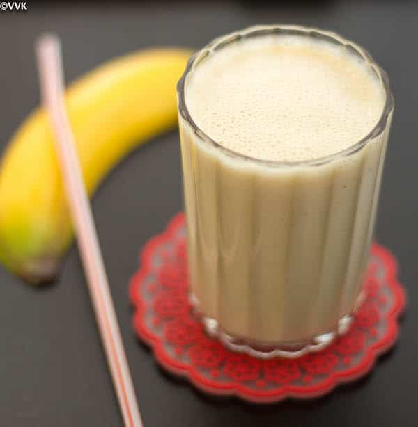 BananaSmoothiePeanut Butter Banana Smoothie served with a banana and straw