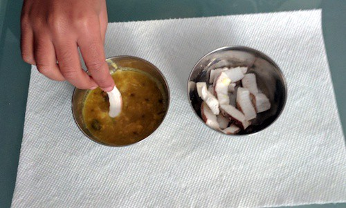 One small bowl of dal and one small bowl of coconut pieces