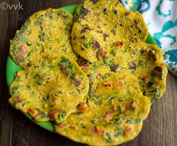 Oats Besan Puda or Chilla served in five delicious pieces on a big green plate