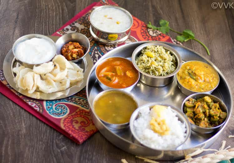 Andhra Telangana Thali Spread served on a beautiful cloth on a wooden table