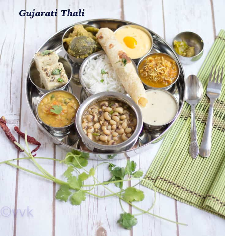 Gujarati Thali tray on a table with text overlay