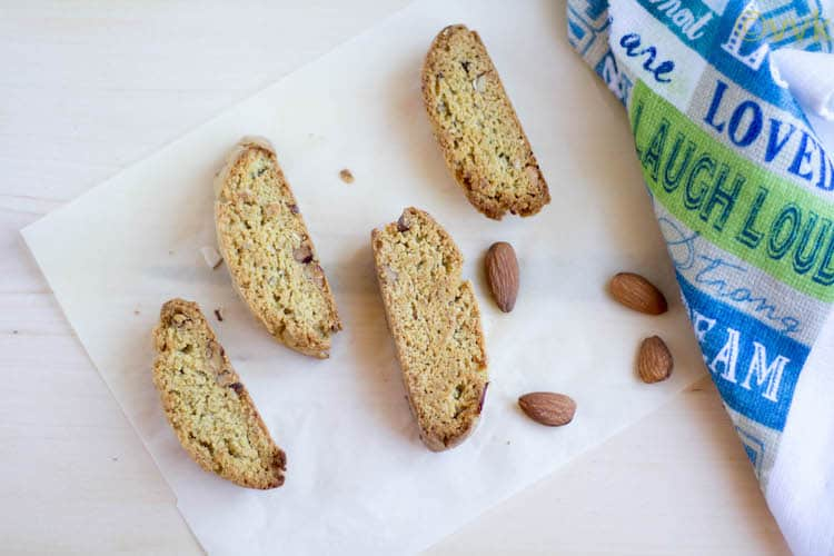 Mandelbrot or Mandel Bread served on a piece of parchment paper with four almonds
