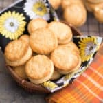 Baked Buttermilk Biscuits served in a bowl on top of a towel with cute flowers