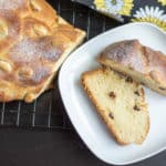 Eggless Vanocka or Czech Braided Christmas Bread served in a white bowl with more of the bread right next to it on the table