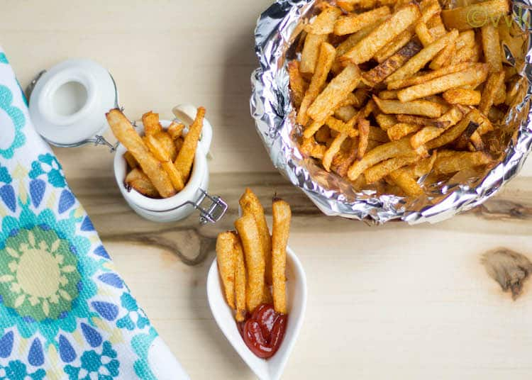 Baked Jicama Fries with ketchup in a small white serveware
