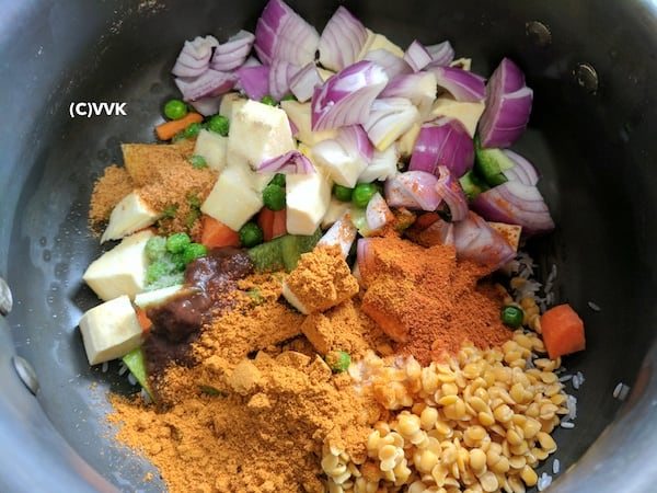 bisi bele bath in pressure cooker - adding all the ingredients