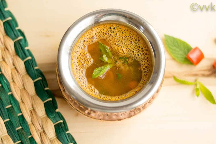 Instant Pot Mint Rasam with Masoor Dal overhead shot of the rasam with mint on top and some blurred in the background