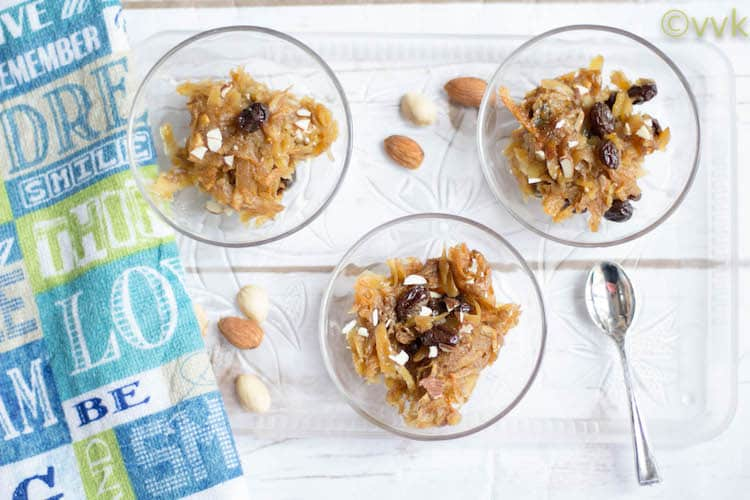 Three cute glass bowls with delicious Vegan Sweet Potato Pone or Sweet Potato Pudding and nuts around the bowls on the table