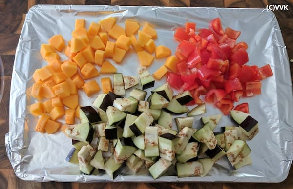 Spread the vegetables in a baking tray covered with foil.