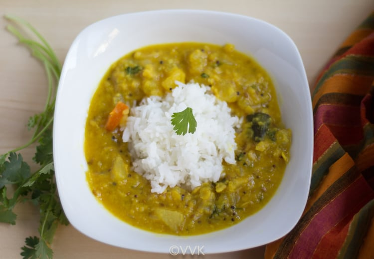 Yellow Cucumber Dal or Instant Pot Dosakaya Pappu served with rice and greens