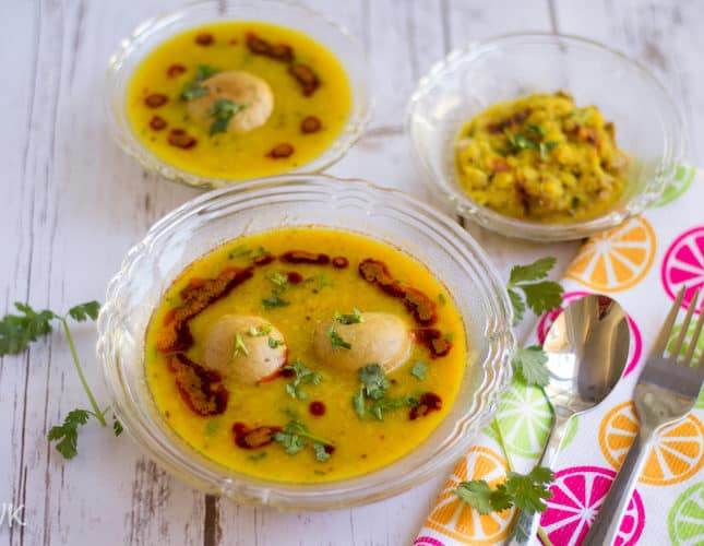 Three bowls with delicious Instant Pot Dal Bafla looking colorful and so inviting