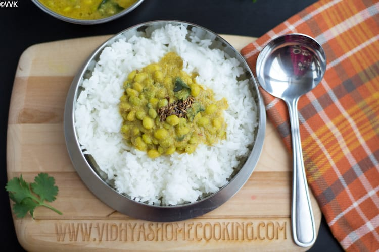 Hyacinth Beans Curry Recipe or Instant Pot Avarekalu Huli Saaru on top of the rice