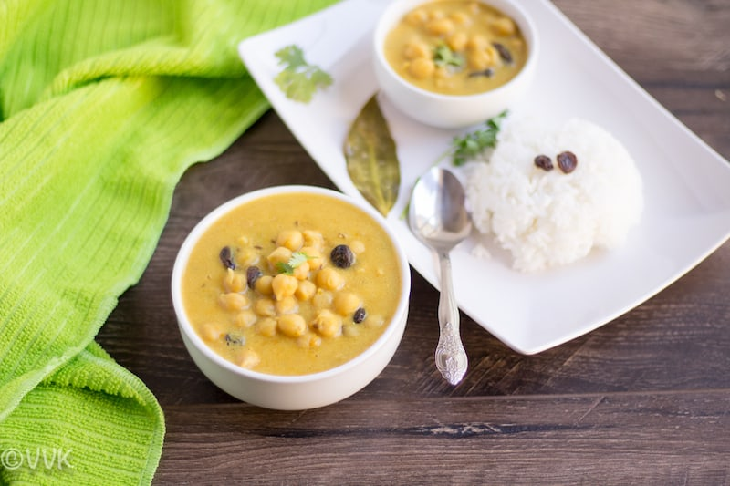 Instant Pot Channa Madra - Pahari Cuisine Special Channa Madra Beautiful Composition with green Fabrics to the Left and the Main Dish on the Wooden Table