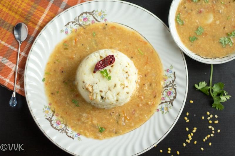 Instant Pot Pesaru Pappu Charu | Munakkaya Pesaru Pappu Charu served with rice in a white place