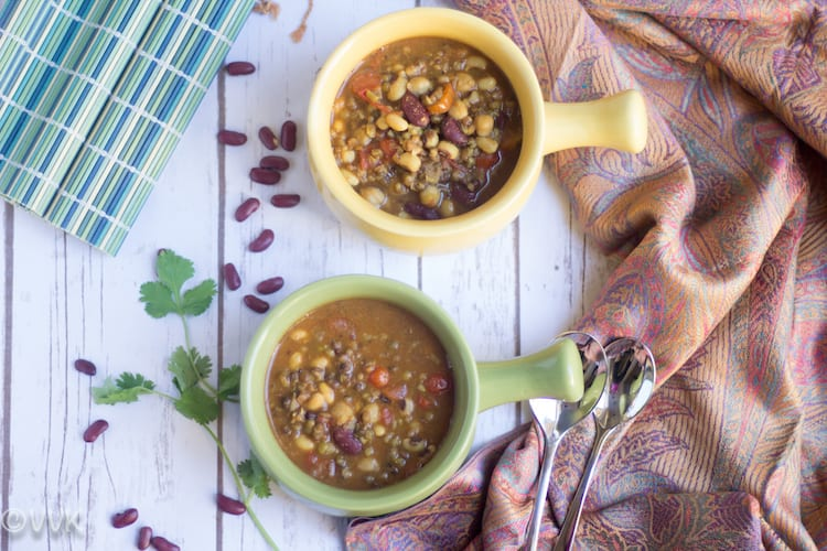Instant Pot Kwati - Mixed Bean Stew - Overhead on the Yellow and Green Bowls Full of the Delicious Dish
