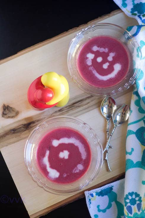 Beetroot Soup served on a wooden board with two spoons
