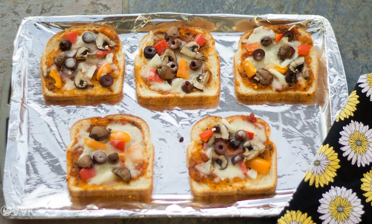 Vegetable Bread Pizza with Tomato-Pesto Sauce served on a tray covered with foyil