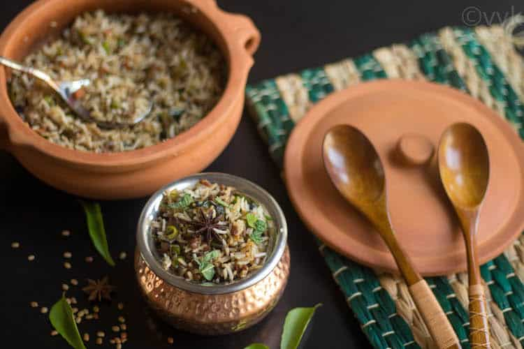 Ulava Charu Vegetable Biryani with a plate and two wooden spoons next to it