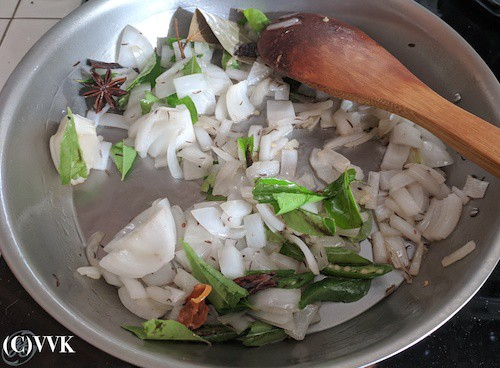 Adding the chopped onion, curry leaves and slit green chilies