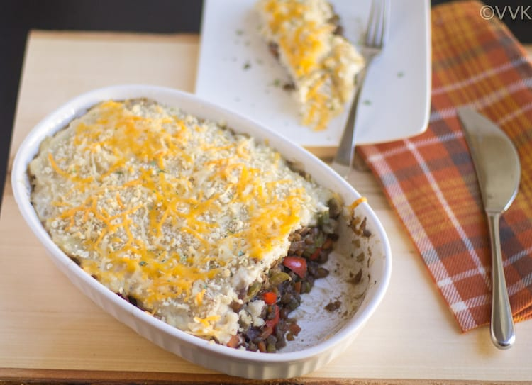 Closeup on the delicious Vegetarian Shepherd's Pie or Lentils and Vegetable Shepherd's Pie presented on a wooden board