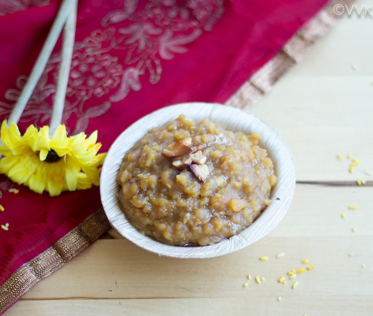 Delicious Instant Pot Hayagreeva Maddi with beautiful fabrics next to it