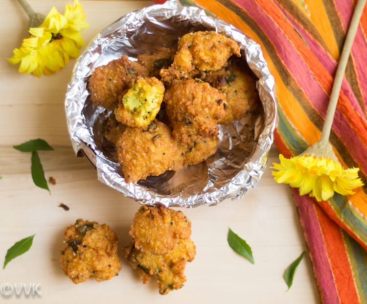 Thavala Vadai closeup with a yellow flower next to the dish