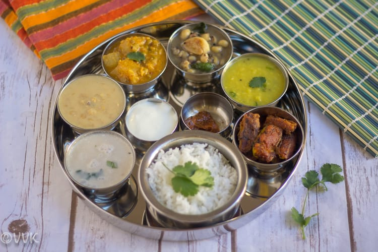 Vegetarian Konkani Thali served in a metal tray