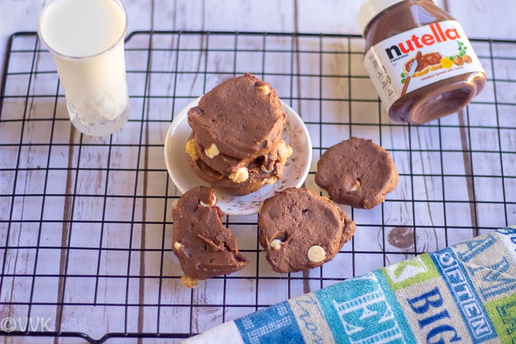 Eggless Nutella Cookies served with a glass of milk