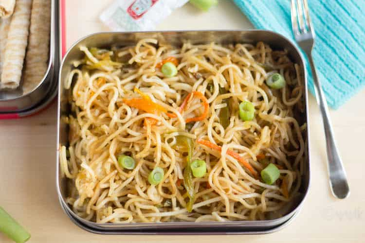 Homemade Veg Hakka Noodles in a box with a fork on a side