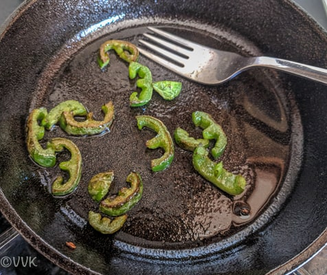 Sauteing jalapenos until they turn light brown on both sides